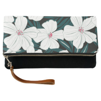 White and red flowers on green leaves clutch