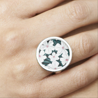 White and red flowers on green leaves ring