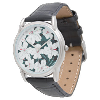 White and red flowers on green leaves watch