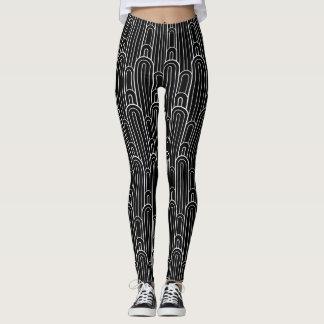 White art deco arch pattern on black background leggings