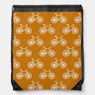White Bicycle, Cycling Pattern; Burnt Orange Drawstring Backpack