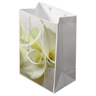 White calla lilies from above medium gift bag