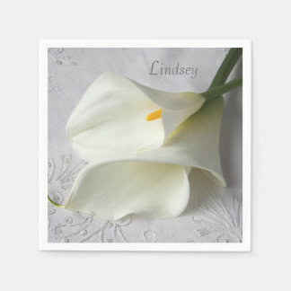 White calla lilies on linen disposable napkin