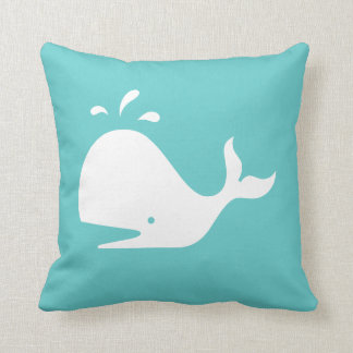 white CARTOON whale  on teal blue pillow