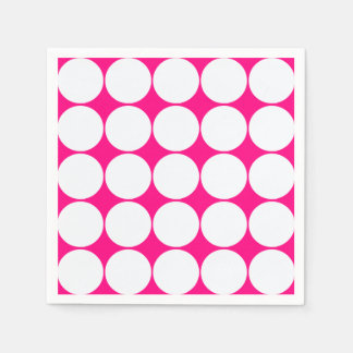 white circles in bright pink paper napkin