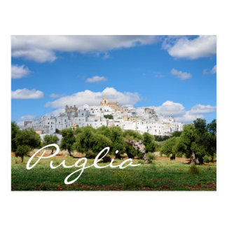 White city and olive trees in Puglia text postcard