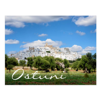 White city Ostuni and olive trees text postcard