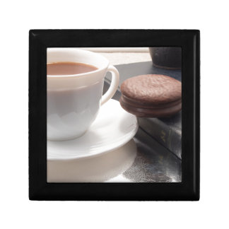 White cup of hot chocolate and cookies gift box