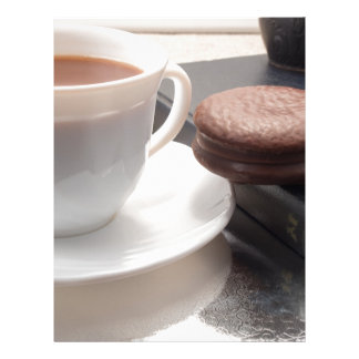 White cup of hot chocolate and cookies letterhead