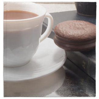 White cup of hot chocolate and cookies napkin