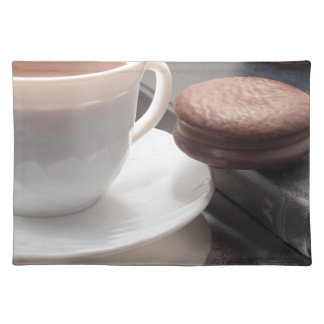 White cup of hot chocolate and cookies placemat