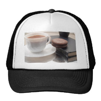 White cup of hot chocolate and cookies trucker hat