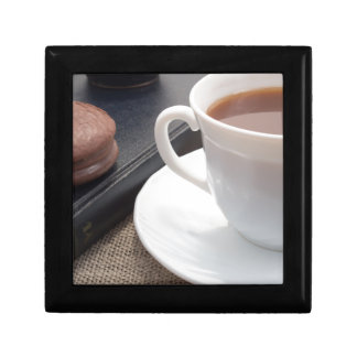 White cup of hot cocoa and a chocolate biscuit gift box