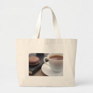 White cup of hot cocoa and a chocolate biscuit large tote bag
