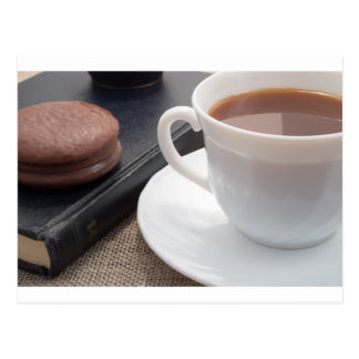 White cup of hot cocoa and a chocolate biscuit postcard