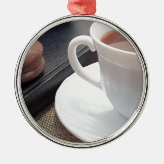 White cup of hot cocoa and a chocolate biscuit Silver-Colored round ornament