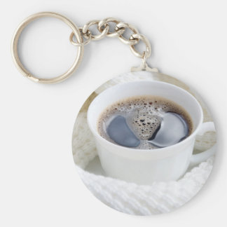 White cup of hot coffee surrounded by a white wool basic round button keychain