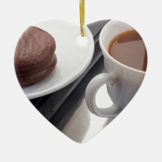 White cup with cocoa and chocolate covered biscuit ceramic heart ornament