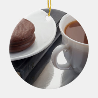 White cup with cocoa and chocolate covered biscuit ceramic ornament