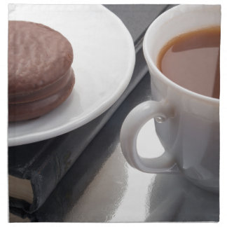 White cup with cocoa and chocolate covered biscuit cloth napkins