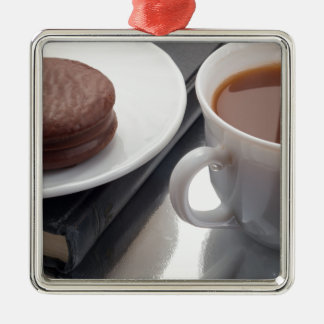 White cup with cocoa and chocolate covered biscuit metal ornament