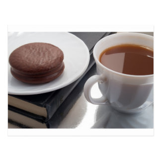White cup with cocoa and chocolate covered biscuit postcard