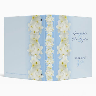 White daffodils on blue binder