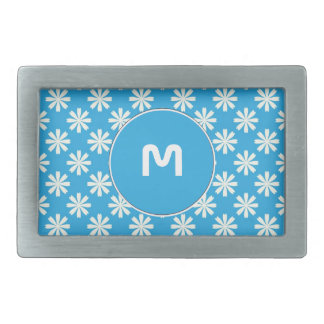 White daisies on baby blue background belt buckles