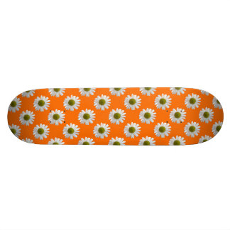 White daisies on orange skate boards