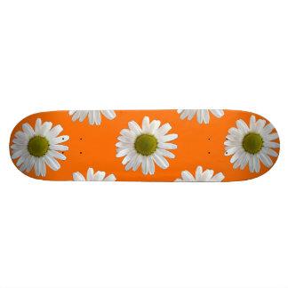 White daisies on orange skate decks