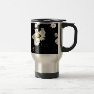 White daisy flowers on dark background travel mug