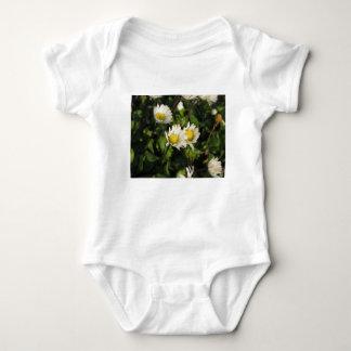 White daisy flowers on green background baby bodysuit