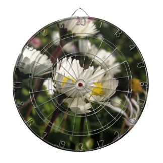 White daisy flowers on green background dartboard