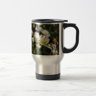 White daisy flowers on green background travel mug