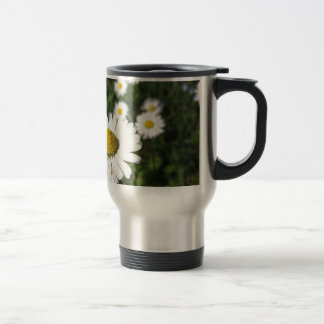 White daisy flowers on green background travel mug