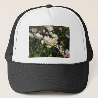 White daisy flowers on green background trucker hat
