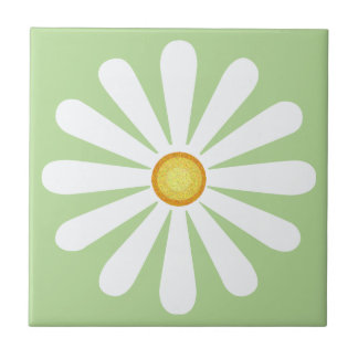 White daisy, yellow centre, on pale green tile