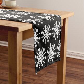 White dotted stars on black short table runner