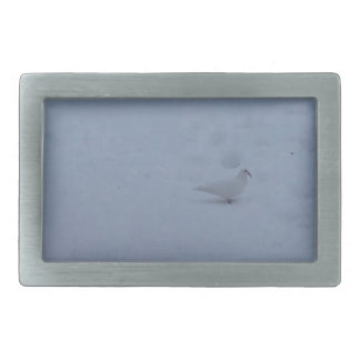 White dove on the snow in the woods belt buckle
