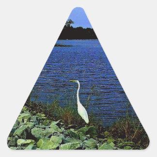 White Egret On Rocky Shore Line Triangle Sticker