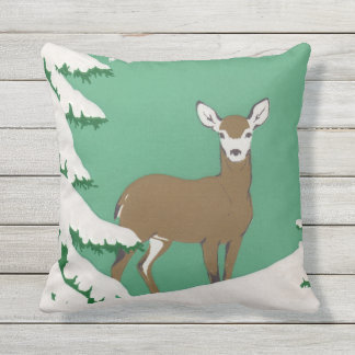 White Faced Brown Deer in snow by Pine Tree Outdoor Pillow
