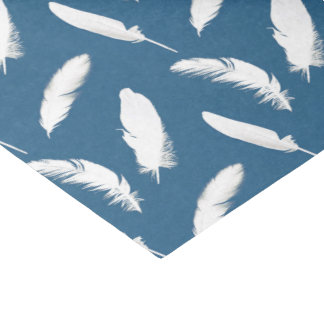 White feather print on denim blue tissue paper