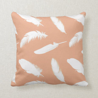 White feather print on soft peach throw pillow