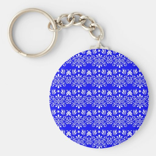 White Floral Pattern on Blue Keychains
