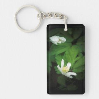 White flower in the darkness keychain