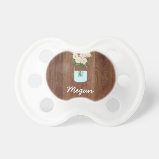 White Flower Mason Jar on Red Wood Baby Pacifiers