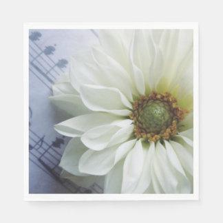 White flower on music paper napkin