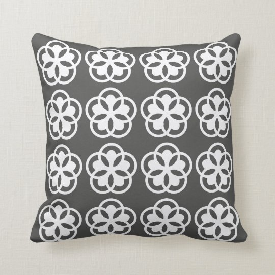white flower pattern on grey throw pillow