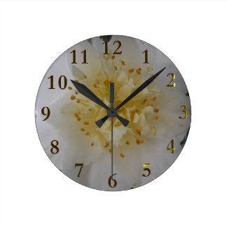 white flower round clock