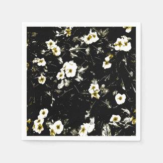 white flowers black napkins